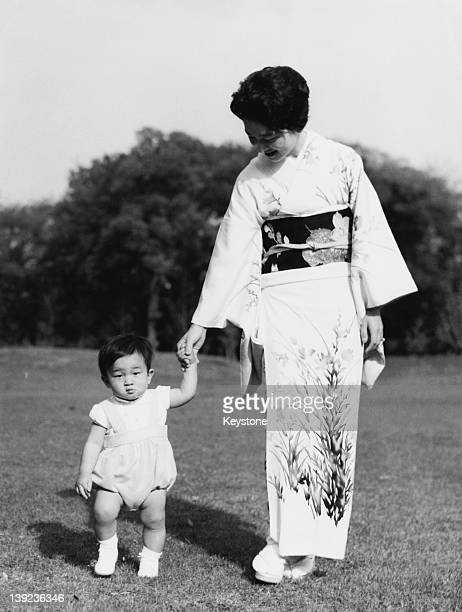 Prince Hiro aka Crown Prince Naruhito of Japan with his mother Empress Michiko in the grounds of Togu Palace in Tokyo 8th May 1961