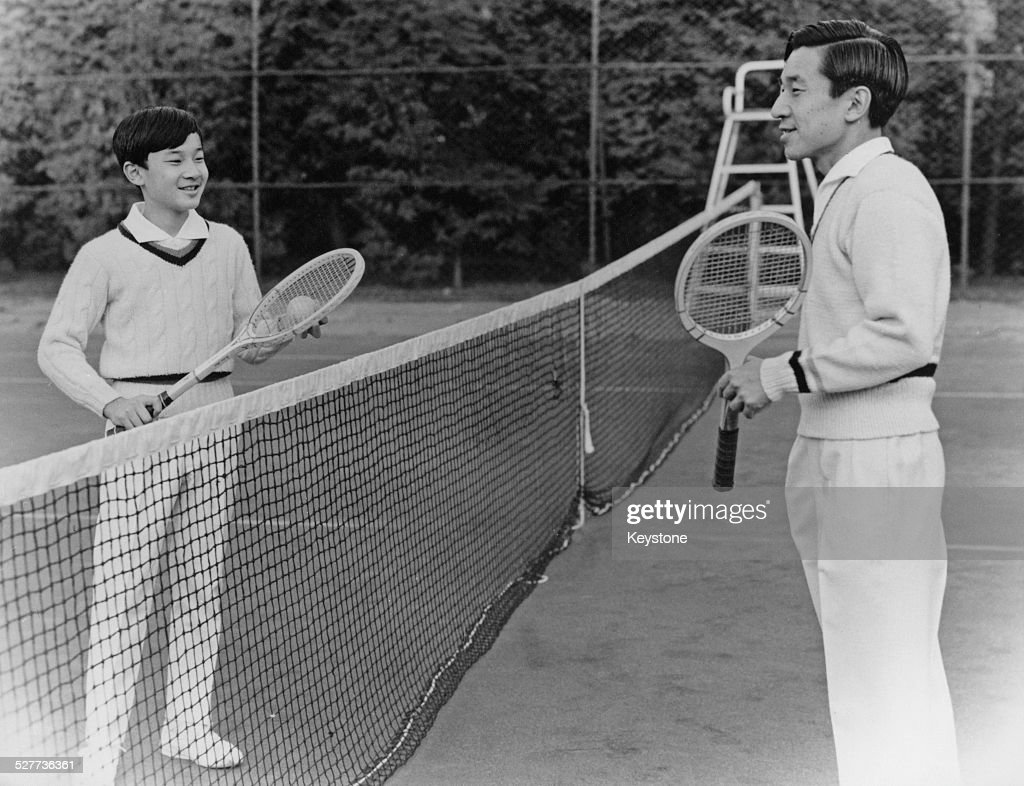 Prince Hiro, the eldest son of Emperor Akihito and Empress Michiko of Japan, playing tennis with his father in Tokyo, around the time of his 13th birthday, February 1973.