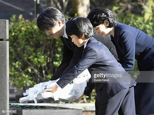 Prince Hisahito his mother Princess Kiko and his father Prince Akishino offer flowers at the Hypocenter Cenotaph in Nagasaki Hypocenter Park in the...