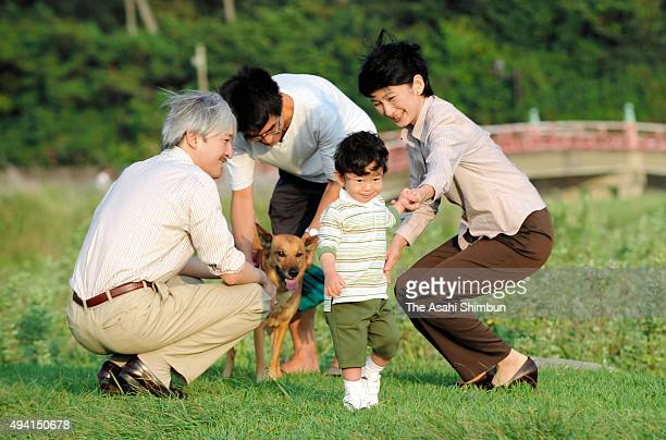 Prince Hisahito plays with Prince Akishino and Princess Kiko of Akishino at Hayama Imperial Villa on September 12 2008 in Hayama Kanagawa Japan