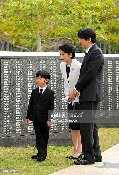 Prince Hisahito Prince Akishino and Princess Kiko of Akishino visit the HeiwanoIshiji at Mabuninooka Peace Memorial on December 10 2013 in Okinawa...