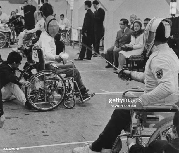 Prince Hitachi and Princess Hanako of Hitach watch the Wheelchair Fencing Men's Sabre Individual matches during the 1964 Tokyo Paralympic Games on...