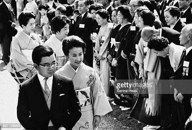 Prince Hitachi son of Emperor Hirohito of Japan with his wife Princess Hitachi at the annual Imperial garden party in the gardens of the Akasaka...