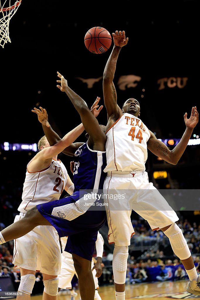 Prince Ibeh #44 of the Texas Longhorns jumps for a rebound during the first round of the 2013 Big 12 Men's Basketball Championship against the Texas Longhorns at Sprint Center on March 13, 2013 in Kansas City, Missouri.