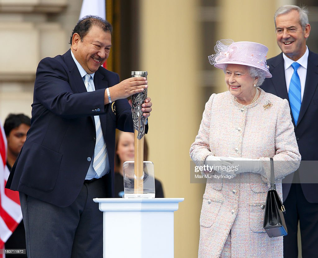 Prince Imran of Malaysia, President of the Commonwealth Games Federation, screws the lid on the 2014 Glasgow Commonwealth Games Baton after Queen <a gi-track='captionPersonalityLinkClicked' href=/galleries/search?phrase=Elizabeth+II&family=editorial&specificpeople=67226 ng-click='$event.stopPropagation()'>Elizabeth II</a> placed her hand-written message to the Commonwealth inside during the launch of the Queen's Baton Relay at Buckingham Palace on October 9, 2013 in London, England. Following the launch, the baton relay will continue it's journey visiting all 70 competing nations and territories ahead of the 2014 Glasgow Commonwealth Games.