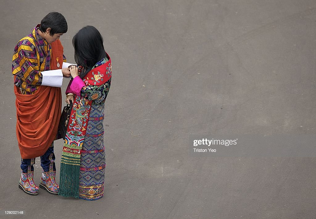 Prince Jigyel Ugyen Wangchuck (L) helping to adjust her badge for his elder sister Her Royal Princess Ashi Sonam Dechen (R) at the outer grounds of Punakha Dzong on October 13, 2011 in Punakha, Bhutan. . King Jigme Khesar Namgyel Wangchuck, 31 and Queen of Bhutan Ashi Jetsun Pema Wangchuck, 21 wed in Bhutan's historic 17th century Punakha Dzong the same venue that hosted the King's historical coronation ceremony in 2008. The marriage of popular, Oxford-educated king was celebrated throughout the country's capital and countryside for several days.