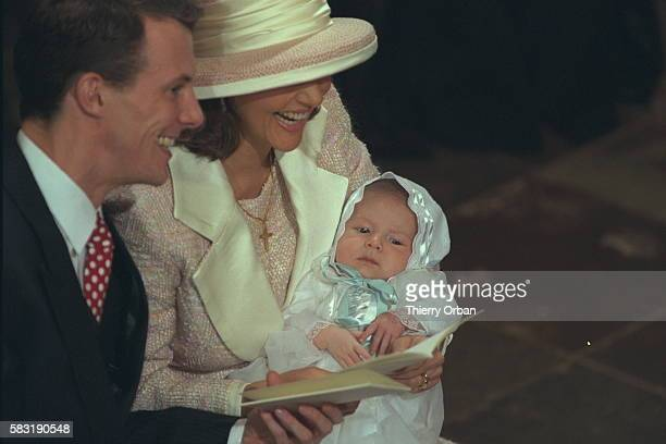Prince Joachim and Princess Alexandra with young Nicolai during the religious ceremony