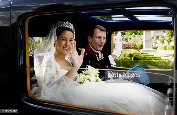 Prince Joachim of Denmark Queen Margrethe's youngest son and bride France's Marie Cavallier wave on May 24 2008 after their wedding vows in...