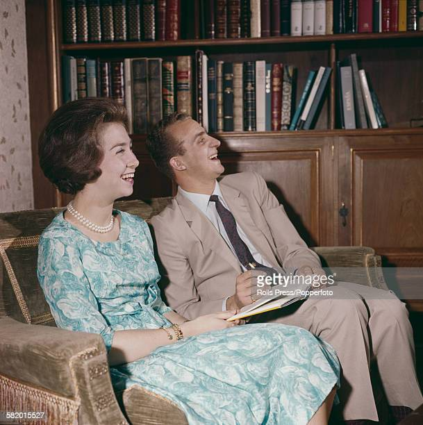 Prince Juan Carlos later Juan Carlos I of Spain pictured sitting with his wife Sophia of Greece and Denmark later Queen Sofia of Spain on a sofa in a...