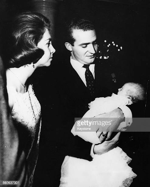 Prince Juan Carlos of Spain and his wife Princess Sophia holding their daughter Princess Elena at the baby's baptism Zarzuela Palace Madrid December...