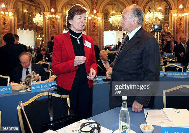 Prince Karim Aga Khan IV chats with Irish former President Mary Robinson while arriving to attend the opening day of the Global Zero a summit to put...