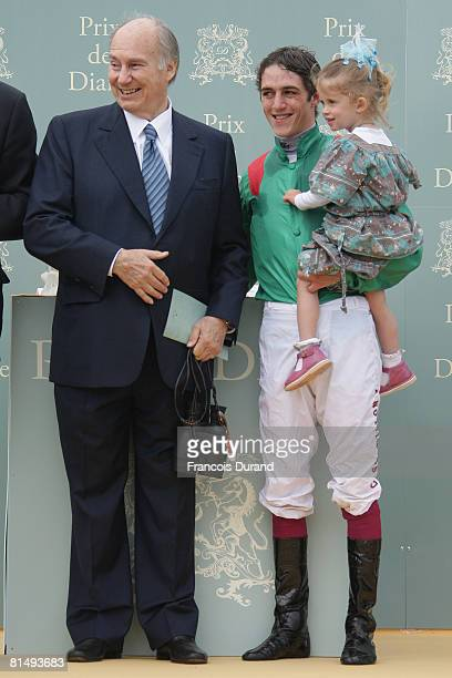 Prince Karim Aga Khan IV the hereditary spiritual Imam of the Shia Imami Ismaili Muslims and Jockey Christophe Soumillon with his daughter at 'Le...