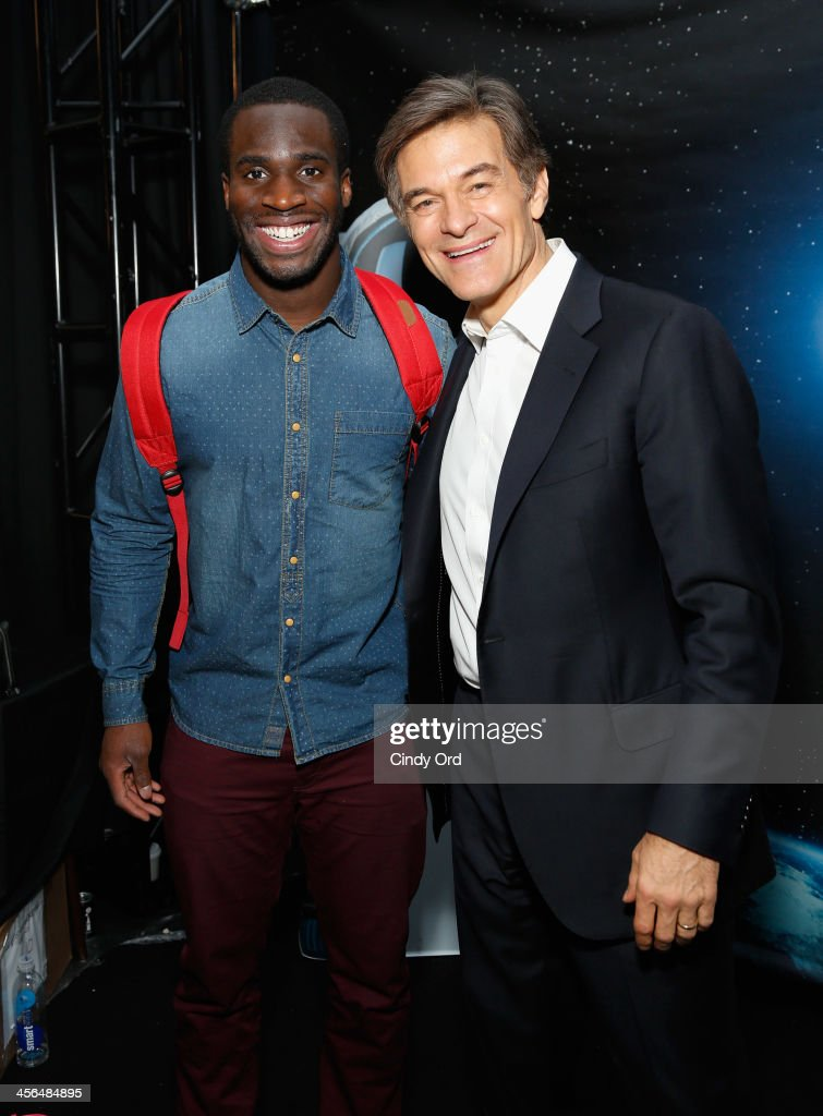 Prince Kelechi Amukamara and Dr. Mehmet Oz attend the Z100's Artist Gift Lounge presented by AXE at Z100's Jingle Ball 2013 at Madison Square Garden on December 13, 2013 in New York City.