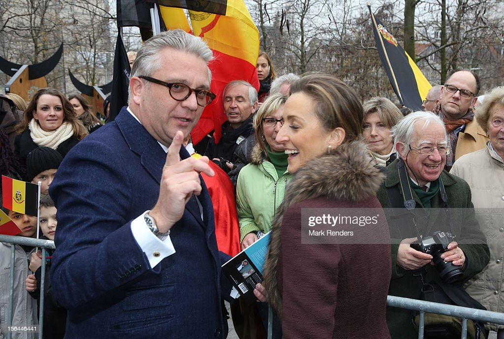 Prince Laurent and <a gi-track='captionPersonalityLinkClicked' href=/galleries/search?phrase=Princess+Claire+of+Belgium&family=editorial&specificpeople=215265 ng-click='$event.stopPropagation()'>Princess Claire of Belgium</a> greet the crowd at Cathedrale des Saints-Michel-et-Gudule on November 15, 2012 in Brussels, Belgium.