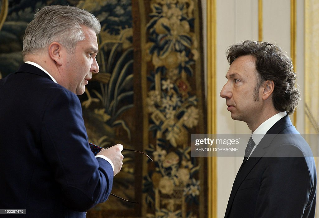 Prince Laurent of Belgium (L) speaks with French journalist, author and producer Stephane Bern during the ceremony in which Bern was declared an Officer in the Order of Leopold, a Belgian national honourary order of knighthood, at the Egmont Palace in Brussels on March 7, 2013. Belgium Out