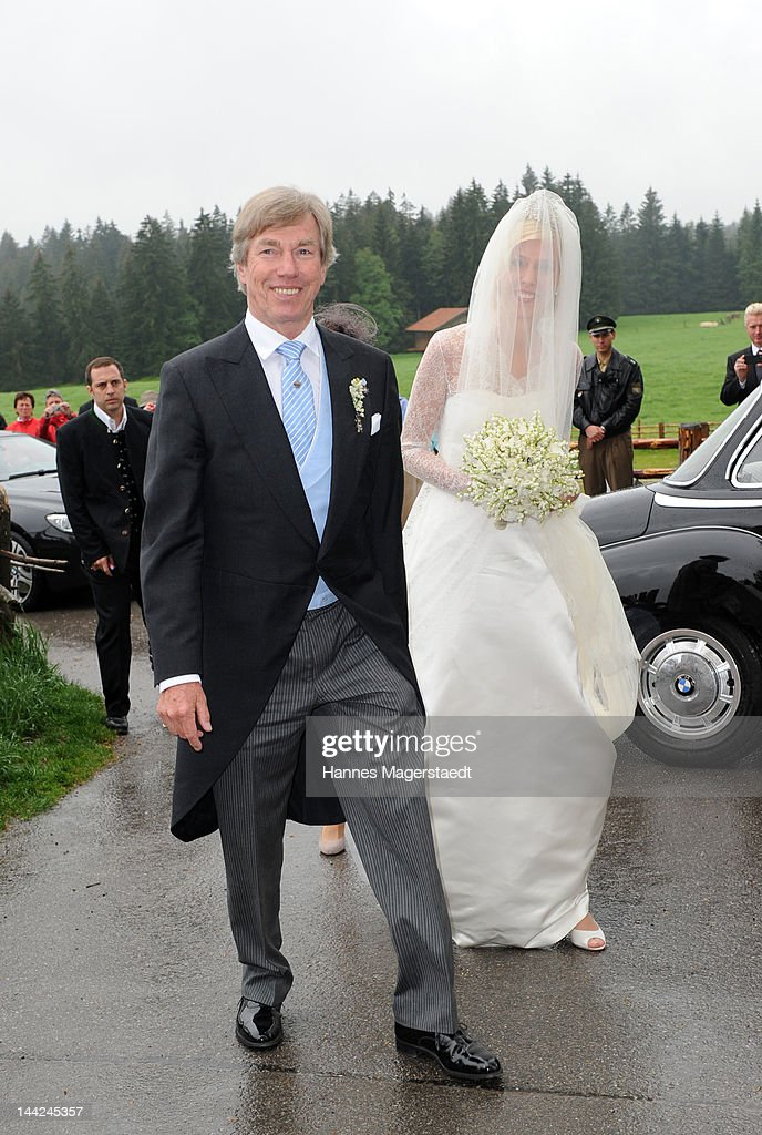 Prince Leopold von Bayern and his daughter Princess Felipa von Bayern arrive at her wedding with Christian Dienst at Wieskirche on May 12, 2012 in Steingaden, Germany.