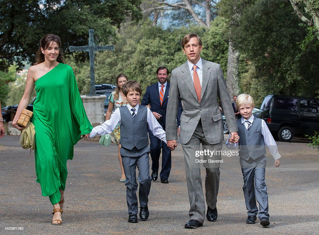 Prince Louis and Princess Tessy of Luxembourg with their children, arrive for the Christening ceremony of Princess Amalia at the Saint Ferreol Chapel in Lorgues on July 12, 2014 in Lorgues, France.