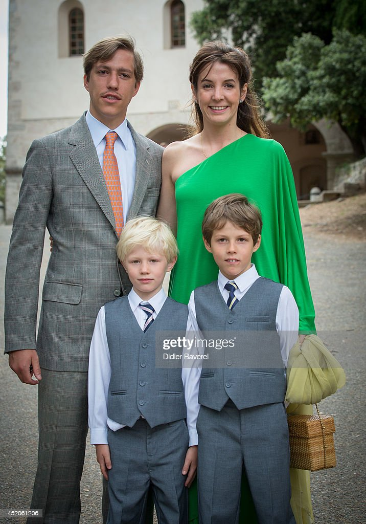 Prince Louis and Princess Tessy of Luxembourg with their children pose after the Christening ceremony of Princess Amalia at the Saint Ferreol Chapel in Lorgues on July 12, 2014 in Lorgues, France.