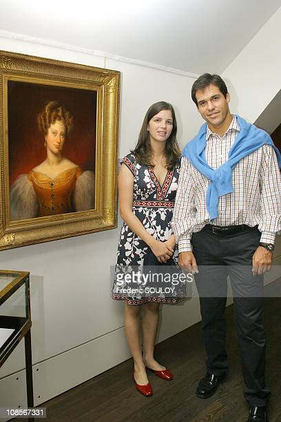 Prince Louis of Bourbon Duke of Anjou Princess MarieMarguerite Duchess of Anjou with portrait of Duchess of Berry in Paris France on June 04 2007