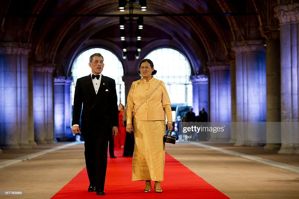 Prince <a gi-track='captionPersonalityLinkClicked' href=/galleries/search?phrase=Maha+Vajiralongkorn&family=editorial&specificpeople=584948 ng-click='$event.stopPropagation()'>Maha Vajiralongkorn</a> and Princess <a gi-track='captionPersonalityLinkClicked' href=/galleries/search?phrase=Maha+Chakri+Sirindhorn&family=editorial&specificpeople=572144 ng-click='$event.stopPropagation()'>Maha Chakri Sirindhorn</a> of Thailand arrive to attend a dinner hosted by Queen Beatrix of The Netherlands ahead of her abdication at Rijksmuseum on April 29, 2013 in Amsterdam, Netherlands.