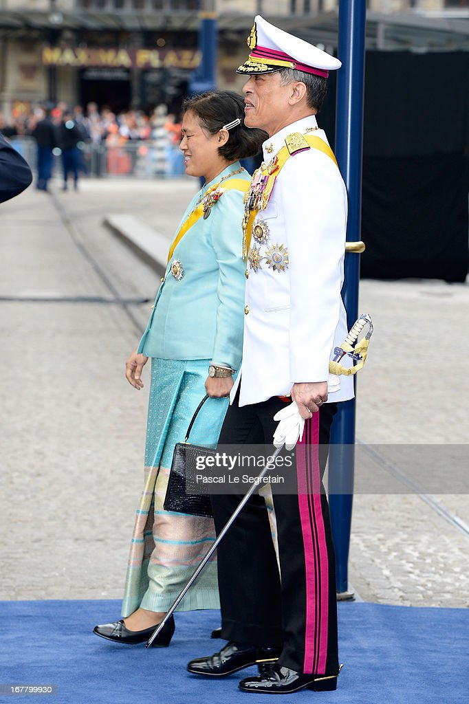 Prince <a gi-track='captionPersonalityLinkClicked' href=/galleries/search?phrase=Maha+Vajiralongkorn&family=editorial&specificpeople=584948 ng-click='$event.stopPropagation()'>Maha Vajiralongkorn</a> and Princess <a gi-track='captionPersonalityLinkClicked' href=/galleries/search?phrase=Maha+Chakri+Sirindhorn&family=editorial&specificpeople=572144 ng-click='$event.stopPropagation()'>Maha Chakri Sirindhorn</a> of Thailand departs the Nieuwe Kerk to return to the Royal Palace after the abdication of Queen Beatrix of the Netherlands and the Inauguration of King Willem Alexander of the Netherlands on April 30, 2013 in Amsterdam, Netherlands.