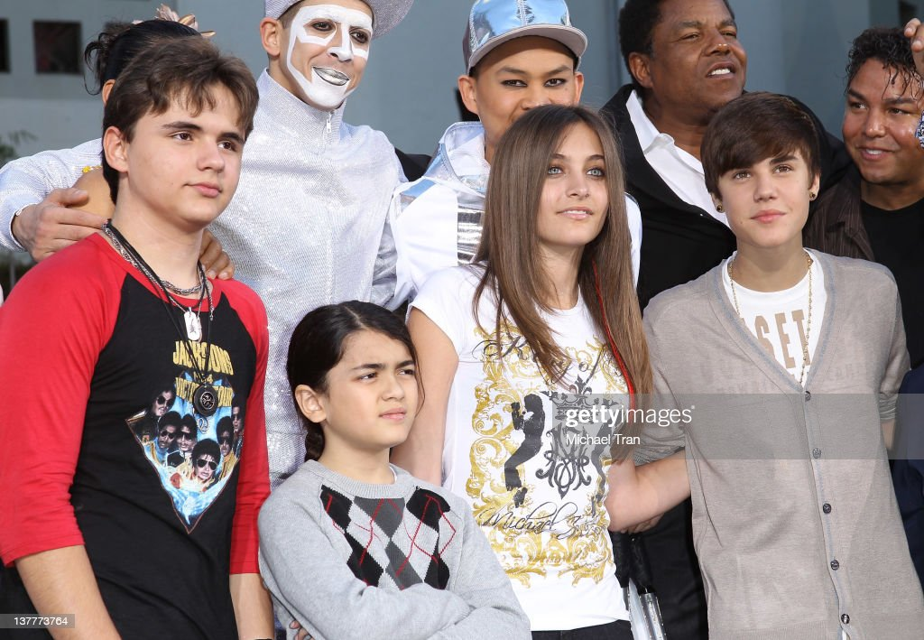Prince Michael, Blanket and Paris Jackson with Justin Bieber attend the Michael Jackson 'Immortalized' hand and footprint ceremony held at Grauman's Chinese Theatre on January 26, 2012 in Hollywood, California.