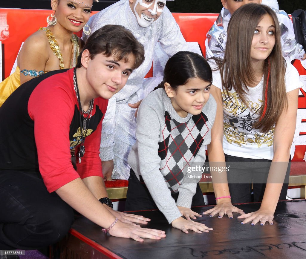 Prince Michael Jackson, Blanket Jackson and Paris Jackson attend the Michael Jackson 'Immortalized' hand and footprint ceremony held at Grauman's Chinese Theatre on January 26, 2012 in Hollywood, California.