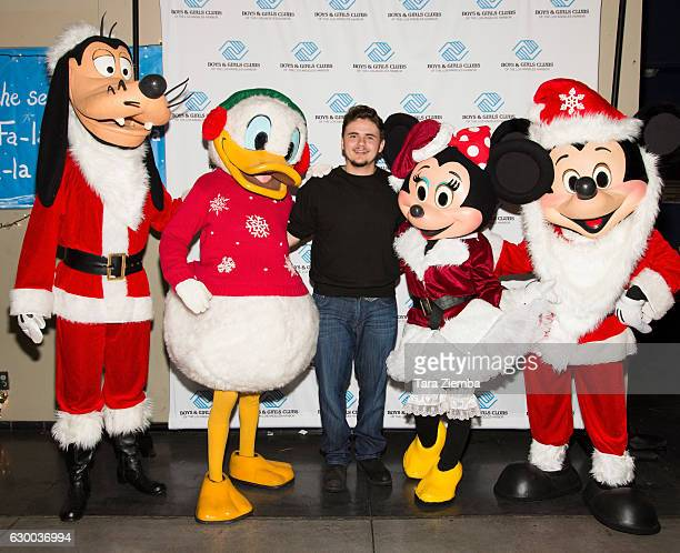 Prince Michael Jackson poses with Disney characters at the 1st annual 'Heal LA Christmas Celebration' at San Pedro Boys Girls Club on December 15...