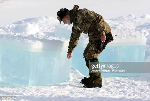 Prince Michael of Kent CommodoreinChief of the Maritime Reserve touches a piece of cut ice from a frozen lake as Royal Marine Reservists take part in...