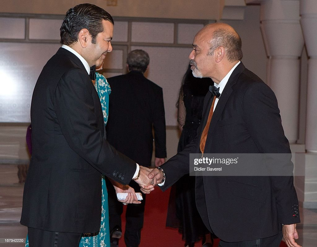 Prince Moulay Rachid of Morocco greets <a gi-track='captionPersonalityLinkClicked' href=/galleries/search?phrase=Christian+Louboutin+-+Fashion+Designer&family=editorial&specificpeople=4644509 ng-click='$event.stopPropagation()'>Christian Louboutin</a> before the Gala Dinner at the Tribute to Hindi Cinema ceremony at the 12th Marrakech international Film Festival on November 30, 2012 in Marrakech, Morocco.
