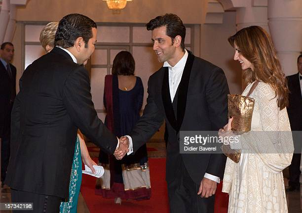 Prince Moulay Rachid of Morocco greets Hrithik Roshan and his wife Susanne before the Gala Dinner at the Tribute to Hindi Cinema ceremony at the 12th...