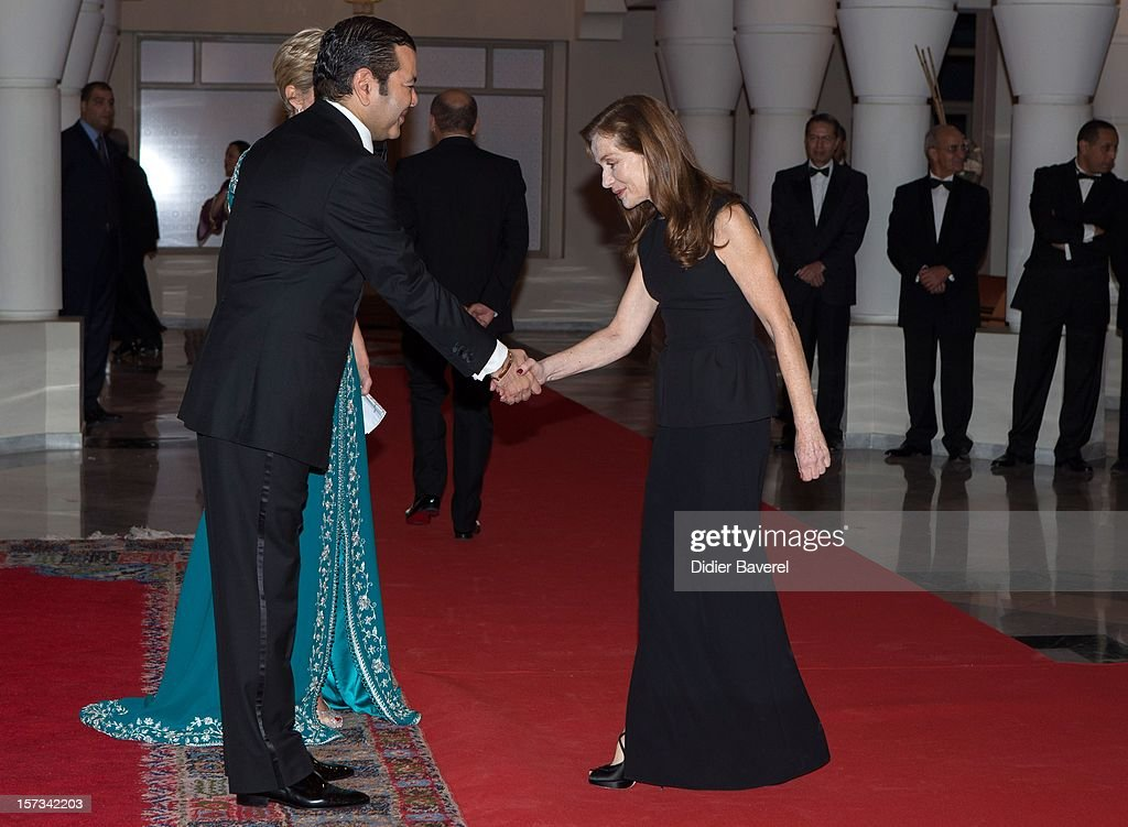 Prince Moulay Rachid of Morocco greets Isabelle Huppert before the Gala Dinner at the Tribute to Hindi Cinema ceremony at the 12th Marrakech international Film Festival on November 30, 2012 in Marrakech, Morocco.