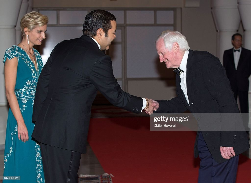 Prince Moulay Rachid of Morocco greets <a gi-track='captionPersonalityLinkClicked' href=/galleries/search?phrase=John+Boorman&family=editorial&specificpeople=213769 ng-click='$event.stopPropagation()'>John Boorman</a> before the Gala Dinner at the Tribute to Hindi Cinema ceremony at the 12th Marrakech international Film Festival on November 30, 2012 in Marrakech, Morocco.