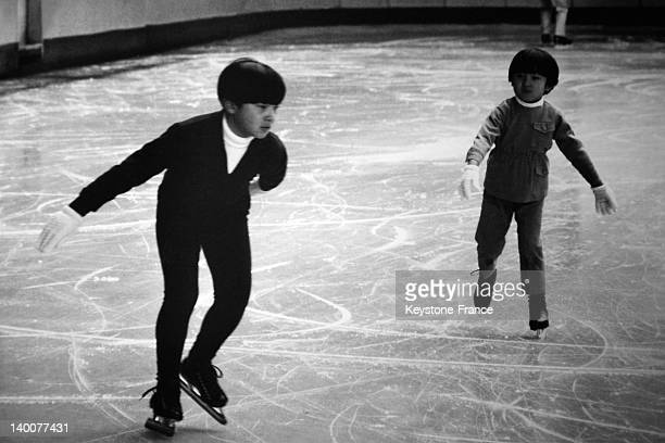 Prince Naruhito and his small brother Prince Akishino practising ice skating as part of their sporting education in the Seventies in Tokyo Japan