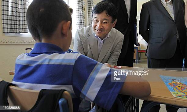 Prince Naruhito of Japan visits a student in a classroom at Vicente Neria in Coria del Rio on June 14 2013 in Sevilla Spain Japanese Crown Prince...