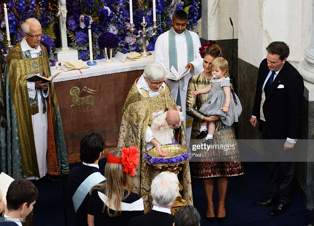 Prince Nicolas of Sween is christened at Drottningholm Palace as Princess Madeleine of Sweden, holding Princess Leonore, and Christopher O'Neill look on during the Christening of their son at Drottningholm Palace on October 11, 2015 in Stockholm, Sweden.