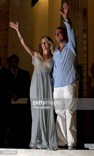 Prince Nikolaos and his fiance Tatiana Blatnik wave from the Poseidon Hotel as they attend their prewedding reception on August 24 2010 in Spetses...