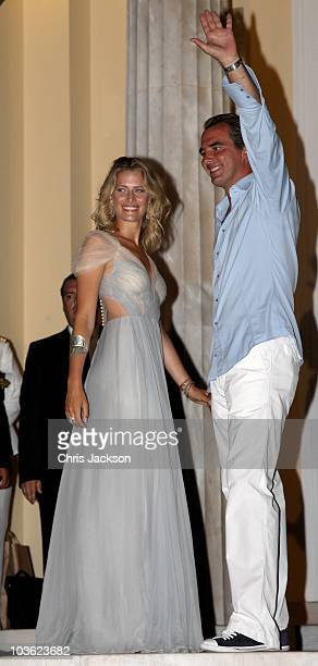 Prince Nikolaos and his fiance Tatiana Blatnik wave from the steps of the Poseidon Hotel as they attend their prewedding reception on August 24 2010...