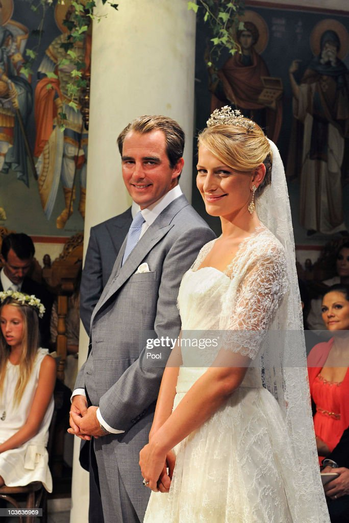 Prince Nikolaos of Greece and Tatania Blatnik (R) pose during their wedding ceremony in the Cathedral of Ayios Nikolaos (St. Nicholas) on August 25, 2010 in Spetses, Greece. Representatives from Europe�s royal families have joined the many guests who have travelled to the island to attend the wedding of Prince Nikolaos of Greece, the second son of King Constantine of Greece and Queen Anne-Marie of Greece and Tatiana Blatnik an events planner for Diane Von Furstenburg in London.