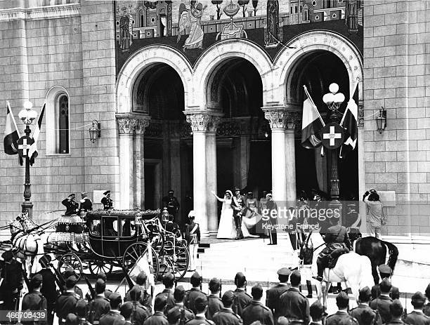 Prince of Asturias Juan Carlos and Princess Sofia of Greece walk out of the church after their religious wedding ceremony on May 14 1962 in Athens...
