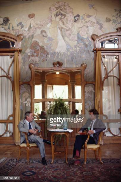 Prince of Belmonte Gaetano Hardouin Monroy Ventimiglia and his son Don Fernando relaxing with a drink in Sicily Italy in October 1984
