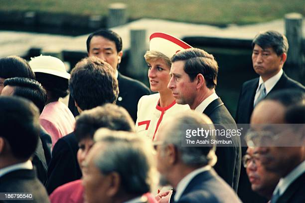 Prince of Wales Prince Charles and Princess of Wales Princess Diana attend a garden party after the Japanese Emperor Akihito enthronement ceremony at...