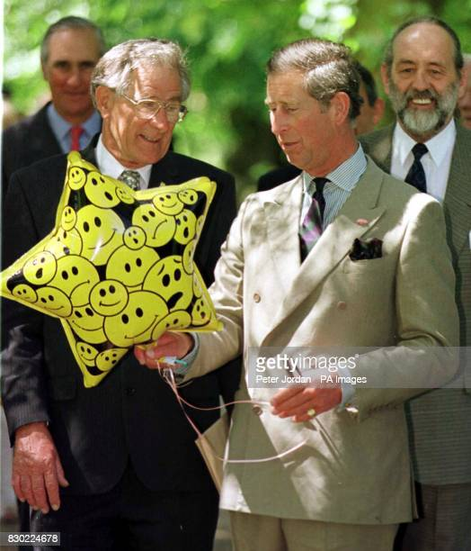 HRH Prince of Wales receives a balloon from a well wisher during a visit to Tethtford Norfol where he unveiled a statue of the first Sikh settler...