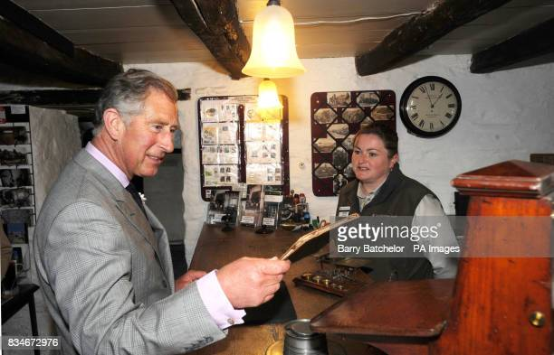 Prince of Wales with behind the counter Jackie Bull in the Old Post Office at Tintagel Cornwall The Prince and Duchess started their two day visit to...