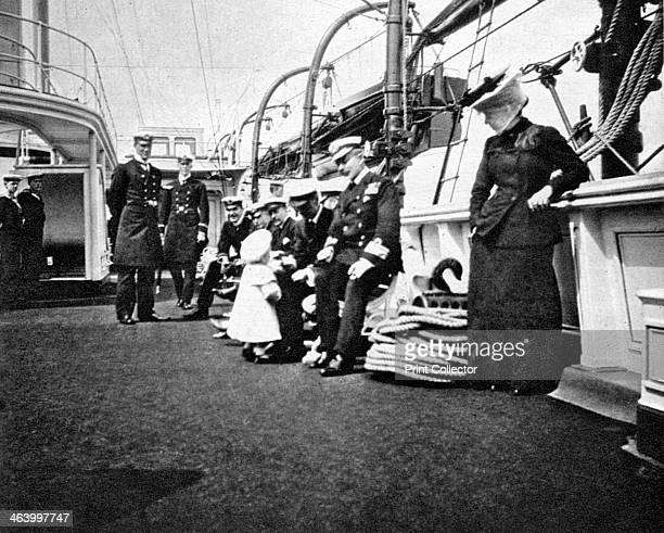 Prince Olav the future King Olav V of Norway conversing with naval officers 1908 From Queen Alexandra's Christmas Gift Book Photographs from My...