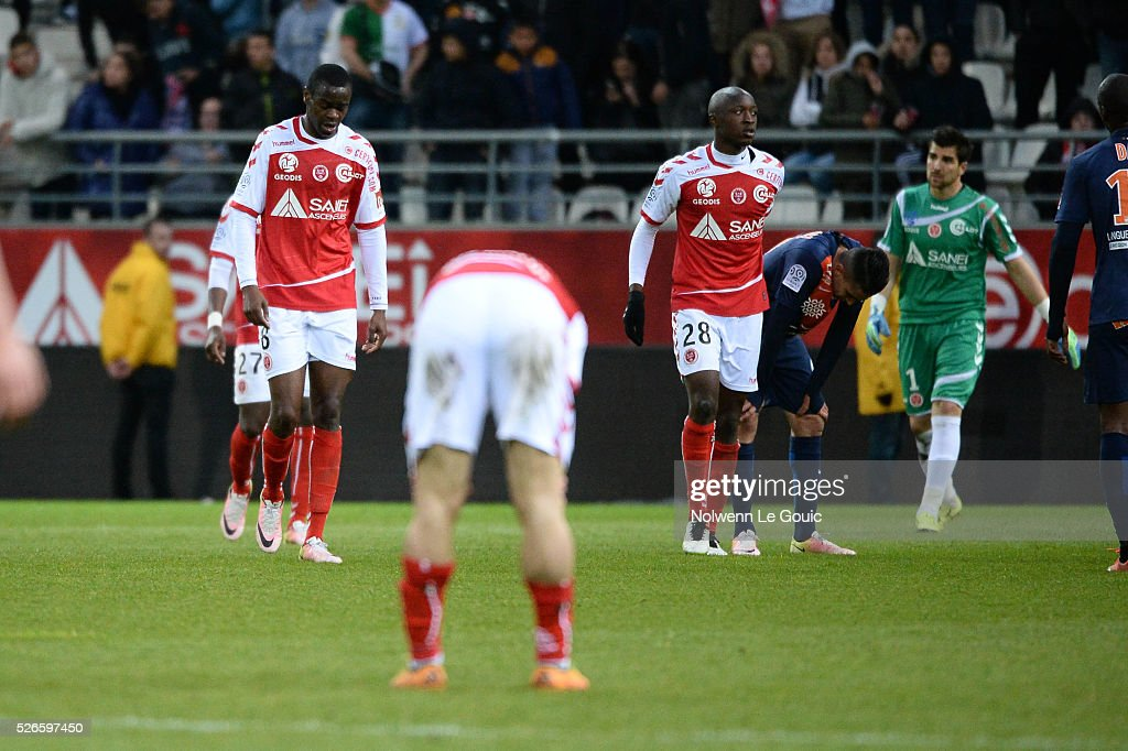 Prince Oniangue and Antoine Conte of Reims are dejected during the French Ligue 1 match between Stade de Reims and Montpellier Herault SC at Stade Auguste Delaune on April 30, 2016 in Reims, France.