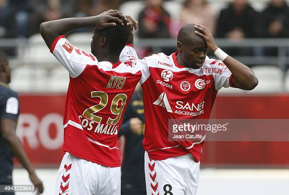 Prince Oniangue and Grejohn Kyei of Stade de Reims react during the French Ligue 1 match between Stade de Reims and AS Monaco at Stade Auguste...