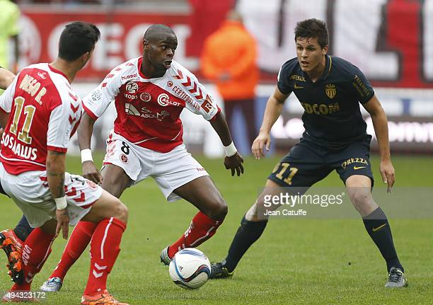 Prince Oniangue of Stade de Reims and Guido Carrillo of Monaco in action during the French Ligue 1 match between Stade de Reims and AS Monaco at...