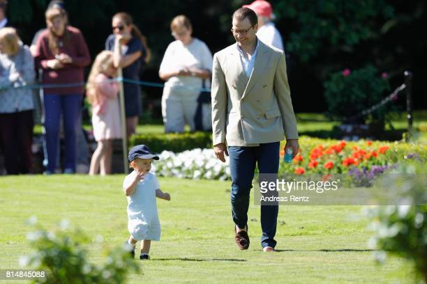 Prince Oscar of Sweden and Prince Daniel of Sweden are seen meeting the people gathered in front of Solliden Palace to celebrate the 40th birthday of...