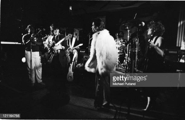Prince performs on stage with Ronnie Wood at a small London club gig after a Wembley show August 1986